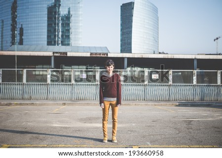 young beautiful hipster woman in the city - stock photo