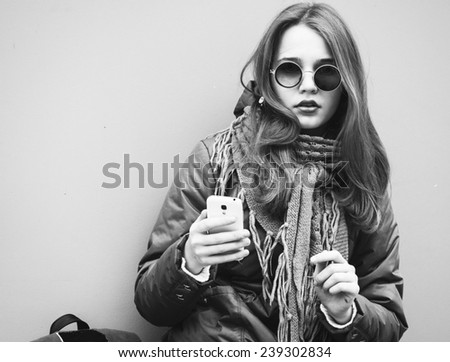young beautiful hipster woman portrait in glasses and knitted clothes  black and white - stock photo