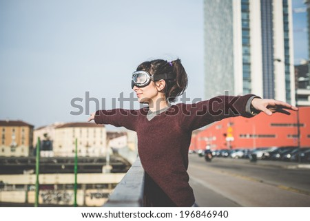 young beautiful hipster woman success aviator glasses  in the city - stock photo