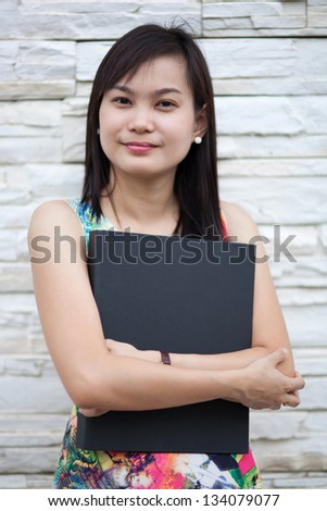 Young beautiful holding a folder