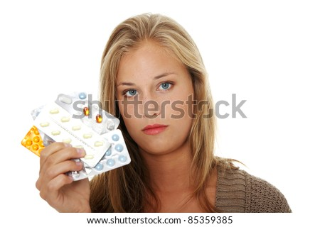 Young beautiful ill woman with pills. Isolated on white background. - stock photo