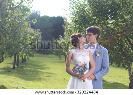 Young beautiful just married couple in the park  - stock photo
