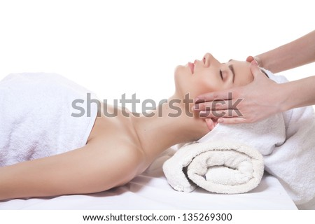 Young beautiful lady getting spa treatment isolated on white - stock photo