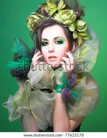 Young beautiful lady in creative artistic image in green shawl