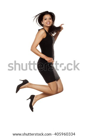young beautiful lady jumping in short black tight dress