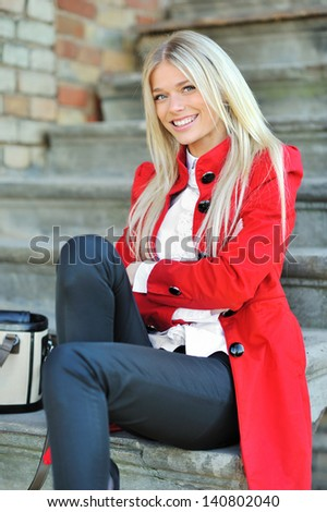 Young beautiful lady portrait smiling outdoors - stock photo