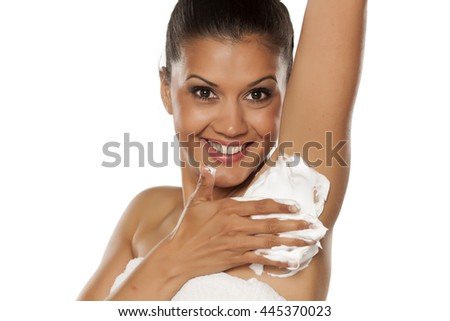 young beautiful latina applied shaving foam on her armpit