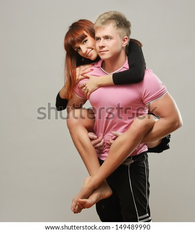 Young beautiful loving couple is embracing - stock photo