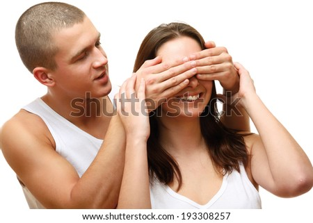 Young beautiful loving couple is embracing - on white background