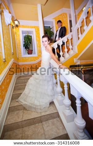 young beautiful marriage couple posing in beautiful interiors - stock photo