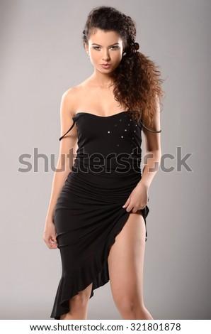 Young beautiful model in fashion image. Studio shot. - stock photo