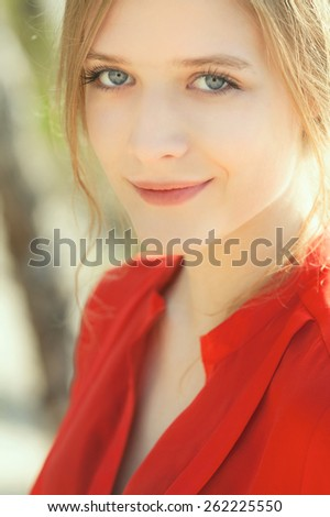 Young beautiful model portrait.  Outdoor shoot - stock photo