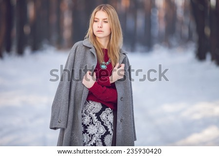 Young beautiful model posing in winter forest. stylish fashion portrait - stock photo