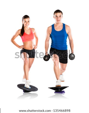 Young beautiful model with fitness balance board - stock photo