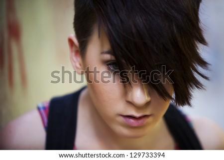 Young beautiful modern looking girl portrait. - stock photo