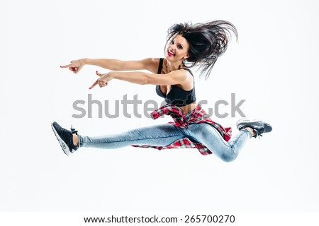 young beautiful modern style dancer posing on a studio background - stock photo