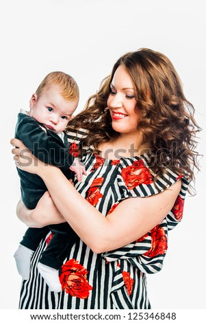 young beautiful mother and charming baby - stock photo
