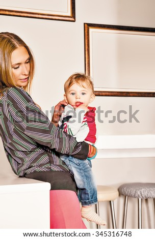 Young beautiful mother embracing her cute  little boy with affection. Copy space frame. - stock photo