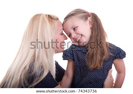Young beautiful mother is whispering a secret to her daughter, isolated on white background - stock photo