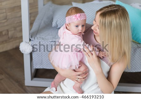 Young beautiful mother playing with her baby. motherhood concept, love and care.