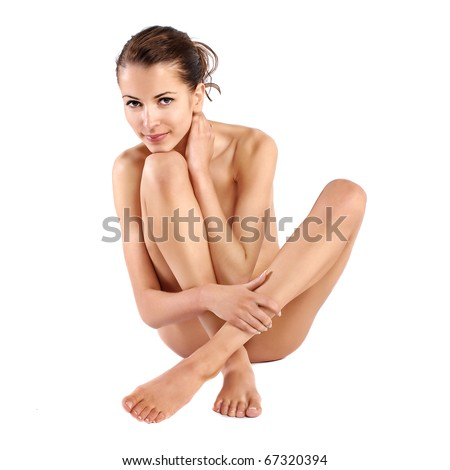 Young beautiful naked woman sitting on a floor - stock photo