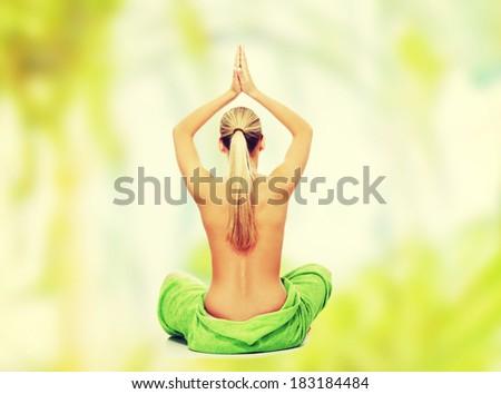 Young beautiful nude blond woman meditating - stock photo