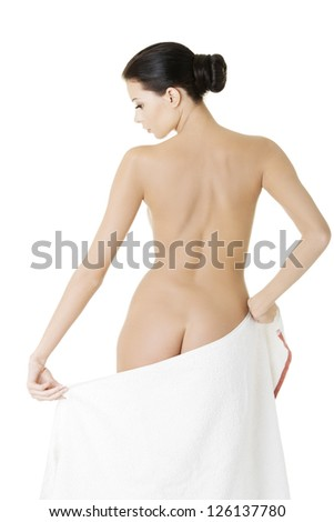 Young beautiful nude woman after bath or spa with towel , isolated on white - stock photo