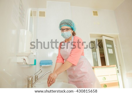 young beautiful nurse washes hands