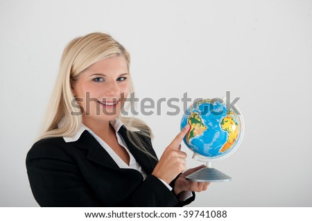 Young beautiful optimistic office business woman with a globe