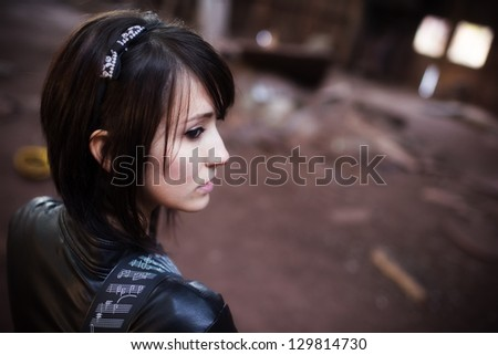 Young beautiful pensive urban woman portrait. - stock photo