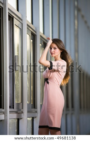 Young beautiful pensive woman at city