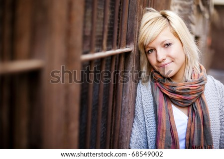 Young beautiful  portrait of a blond girl. Focus on the right eye. - stock photo