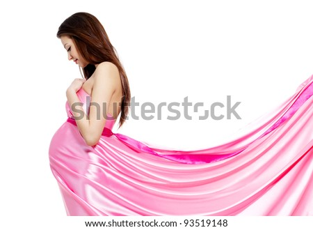 Young beautiful pregnant woman in rosy dress - white background - stock photo