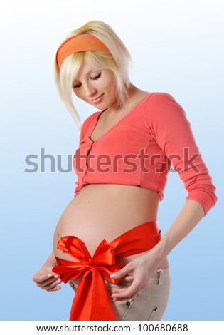 Young beautiful pregnant woman isolated - stock photo