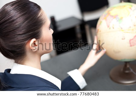 young, beautiful professional planning her career travel - stock photo