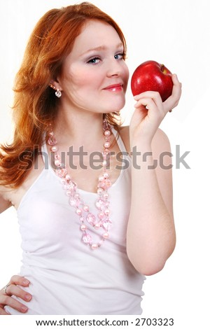 young beautiful red woman with red apple on the white background