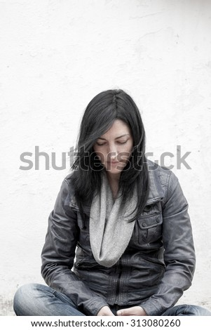 Young beautiful relaxed girl with her eyes closed - stock photo
