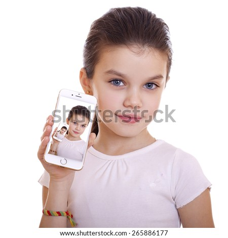 Young beautiful schoolgirl shows a new smart phone, isolated on white background