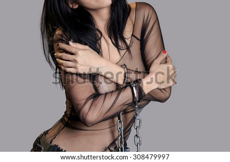 Young beautiful Sexy Asian woman wearing elegant lingerie with gun and chain