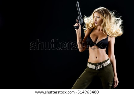 Young beautiful sexy blond Woman holding Handgun
