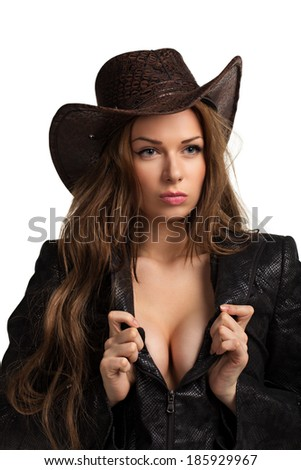 Young beautiful sexy girl in a leather jacket and a cowboy hat. Isolated on the white