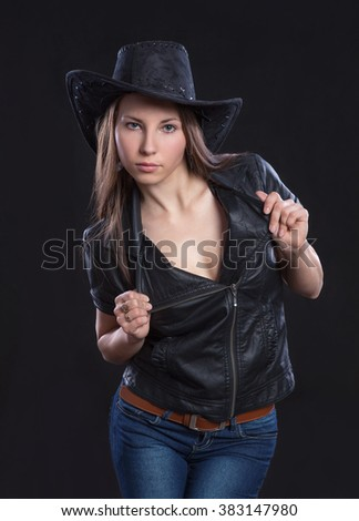 Young beautiful sexy girl in fur waistcoat and  cowboy hat  - stock photo