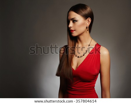 young beautiful sexy woman with big breasts.Beauty brunette girl with perfect body.elegant lady in red dress.plastic surgery - stock photo