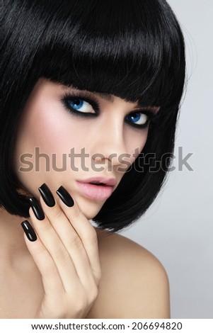 Young beautiful sexy woman with stylish bob haircut and black manicure - stock photo