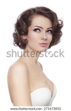 Young beautiful sexy woman with stylish curly hairdo looking upwards over white background - stock photo