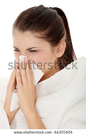 Young beautiful sick woman sneezeing ,isolated on white background