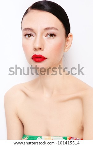 Young beautiful slim model with red lipstick over white wall - stock photo