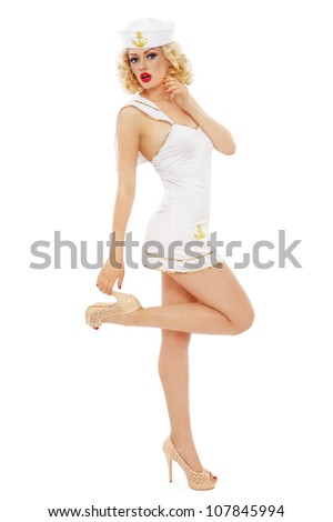 Young beautiful slim sexy girl with blond curly hair and stylish make-up dressed as sailor, over white background - stock photo