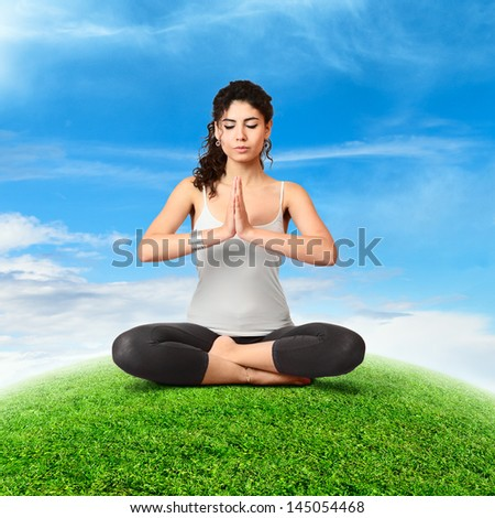 Young beautiful slim woman doing yoga relaxing on abstract small green planet - stock photo