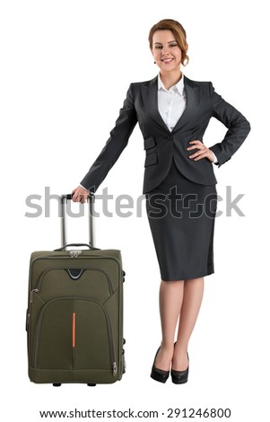 Young beautiful smiling business  woman standing with travel suitcase. Business travel and vacation concept. Isolated on white background